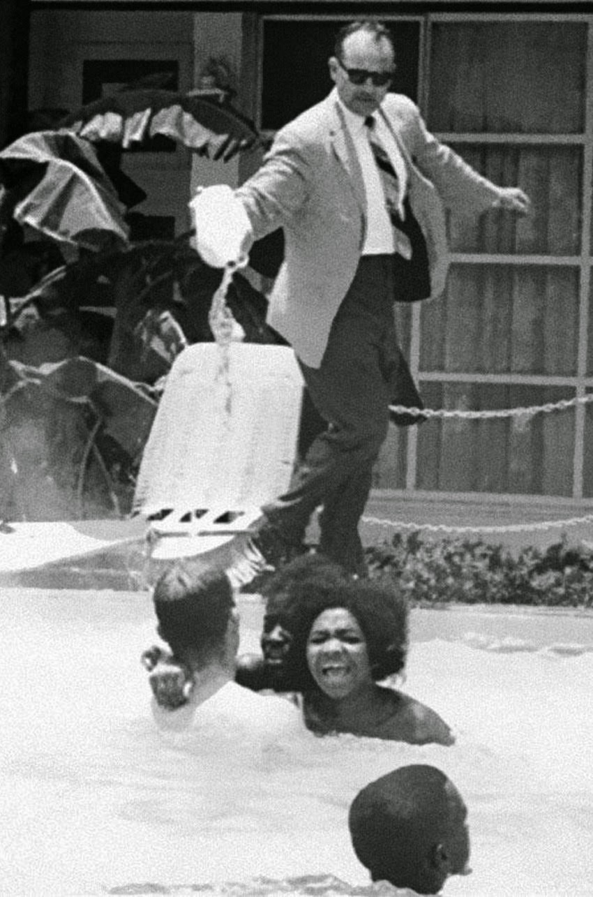 Motel manager pouring acid in the water when black people swam in his pool, 1964